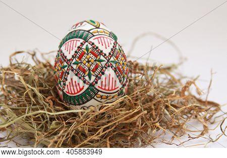 Isolated Traditional Handmade Easter Eggs Vintage Decoration On Hay. Seasonal Motif On Hand Wax Pain
