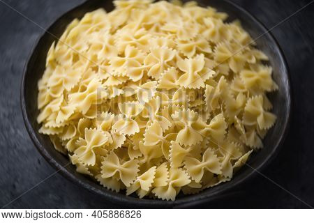 Close Up Of Bowl Of Italian Farfalle Pasta Raw Uncooked Blur Defocused