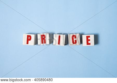 Price Word On Wooden Blocks. Business Concept Of Falling Market Value. Promotions And Sale. Reduced