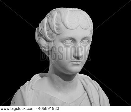 Ancient white marble sculpture bust of Faustina the Younger. Wife of Roman Emperor Marcus Aurelius. Statue of young woman isolated on black