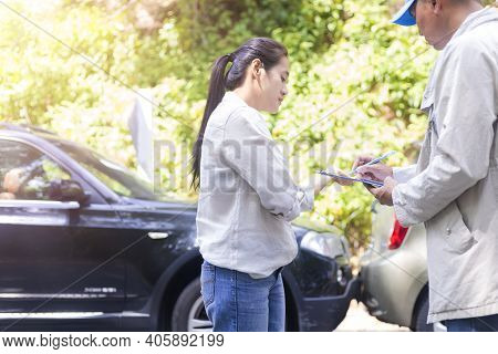 Car Accident Car Crash The Woman Talking To  Insurance Agent About The Accident. Insurance Agent Wri