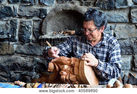 Woodcarver At Work
