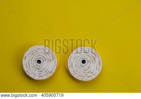 New Replaceable Filters For Industrial Respirator With Yellow Background. Personal Respiratory Prote