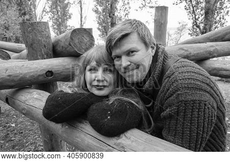 Romantic Heterosexual Lover Couple Of Middle-aged Looking Into The Camera. Family, Relationship Conc