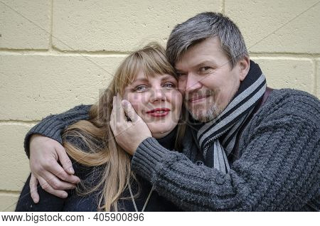 Family, Relationship Concept.  Romantic Heterosexual Lover Couple Of Middle-aged. A Man Embraces A W