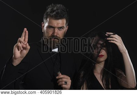 Funeral. Priest Blessing Gesture. Pastor With Woman-widow