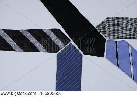 Five Colored Man's Neckties On The White Background. Studio Photo. Several Multicolored Neckties. Hi
