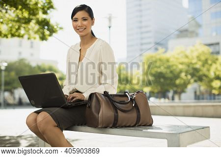 Washington Dc, United States,a Women Employee In Outdoor Working On Laptop