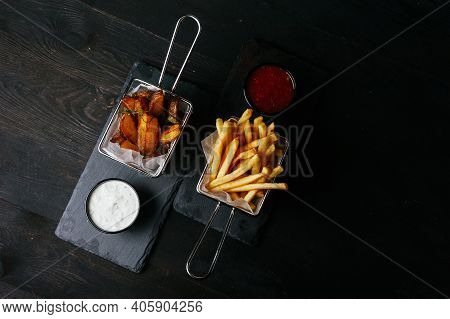 A Very Nice Photo Of Some Fastfood Nuggets And Some French Fries