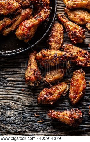 Chicken Wings Barbeque In A Cast Iron Baking Dish - Top Of View.