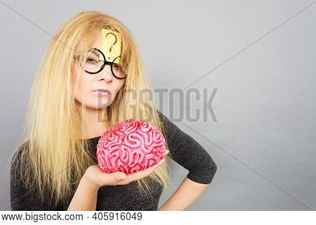 Weird Blonde Woman Holding Brain Having Something On Mind, Thinking Of Idea.