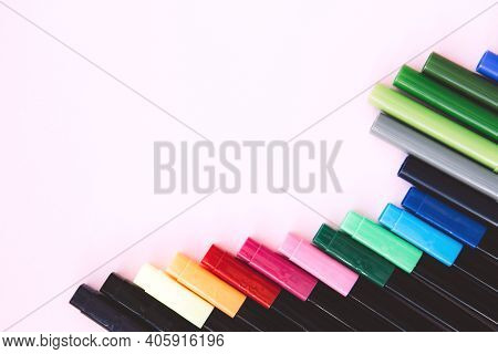 Set Of Colorful Marker Pen On Pink Background. Vivid Highlighters And Blank Space For Your Design Or
