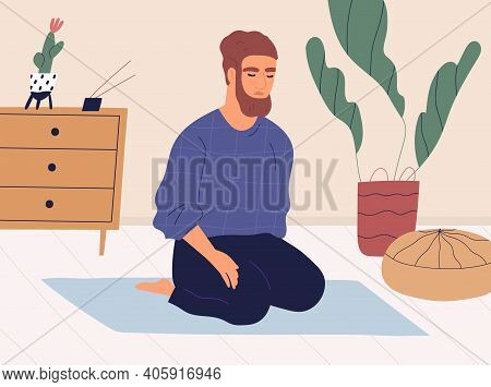 Man Meditating And Performing Breath Control Exercises In Kneeling Position On Mat. Peaceful Relaxed