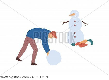 Young Man Rolling Snowball And Making Snowman With Carrot Nose And Arms From Branches. Winter Activi