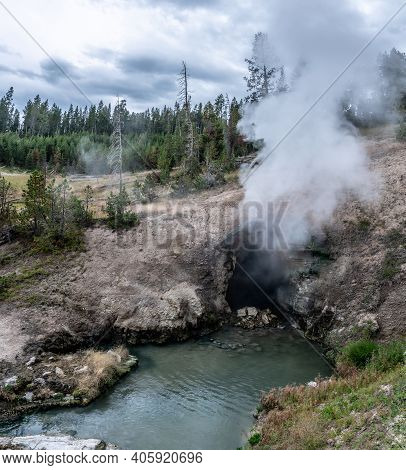 Hot Spring And Geiser In Yellowstone National Par