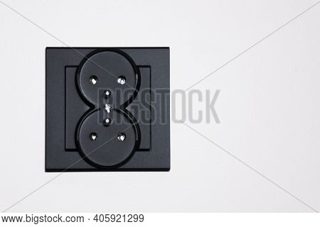 New Electrical Socket Isolated On Gray Wall. Renovated Studio Apartment Power Supply Background. Bla