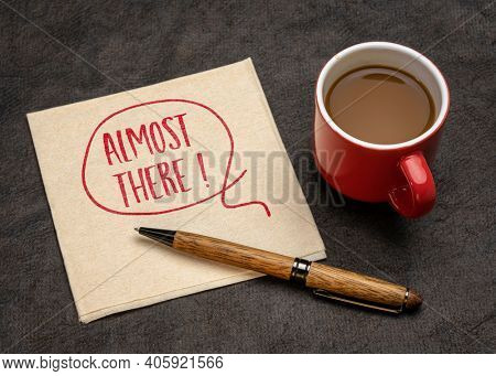 almost there eclamation - handwriting on a napkin with a cup of coffee, reaching goal or destination concept