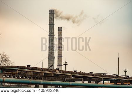 Smoke Emissions From Two Pipes Of An Industrial Enterprise. Pollution Of The Environment.