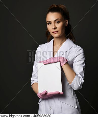 Young Pretty Brunette Woman Doctor Therapist Nurse In White Uniform And Protective Gloves Holding Bl