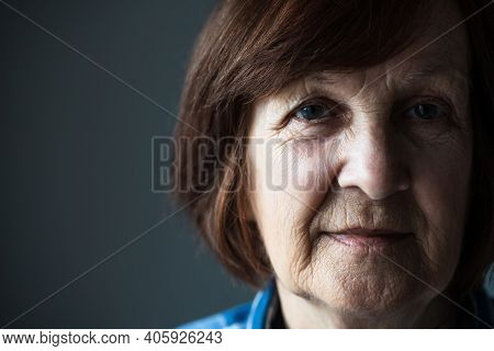 Close-up Portrait Of Senior Woman's Wrinkled Face.