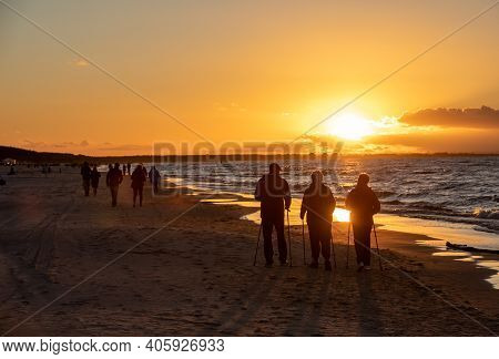 Stegna, Poland - September 7, 2020: Active And Healthy Lifestyle. Nordic Walking On A Sandy Beach Se