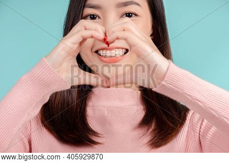 Close Up Lover Dental Retainer Of Asian Woman Wearing After Braces Beauty Smile With White Teeth Inc