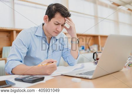 Tired Businessman At Workplace In Office Holding His Headache Or Angry. Overworking, Making Mistake,