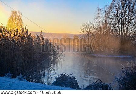 Sunrise And Mist Over Small Pond I Kumla Lakepark Sweden