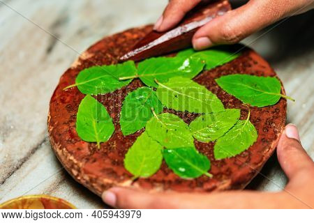Hindu Puja Ritual Preparation Background. Closeup Image Of Sandalwood Stick Or Chandan With Grinding