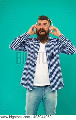 Best Gifts For Music Lovers. Bearded Hipster Wear Headphones. Excellent Sound. Music Library Concept