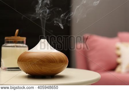 Aroma Oil Diffuser On Table In Room. Space For Text