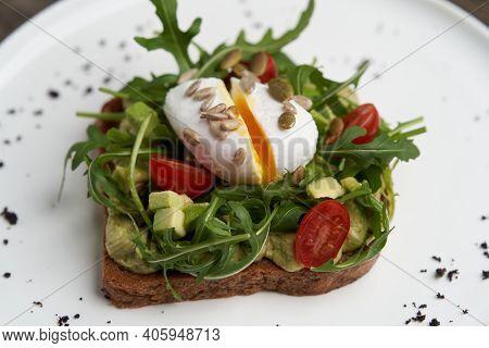 Poached Egg Toast With Guacamole Avocado Sauce.