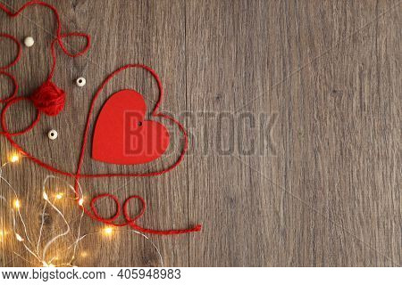 Happy Valentine's Day Hearts On Wooden Background. Heart And From Tree And Thread Valentine's Day Gr