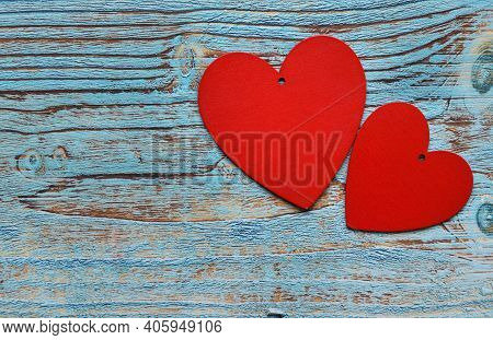 Valentine's Day Background. Two Hearts Of Red Color Isolated On A Wooden Background. Love, Wedding D