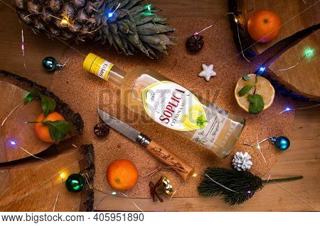 Kyiv, Ukraine - Dec 12, 2020: Vodka Soplica With Lemon. Lemon Vodka And Holiday Lights. Top.