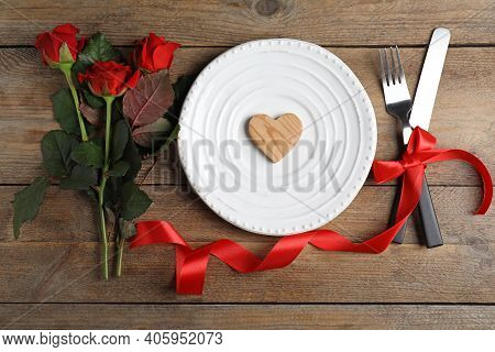 Beautiful Place Setting For Romantic Dinner On Wooden Table, Flat Lay. Valentine's Day Celebration