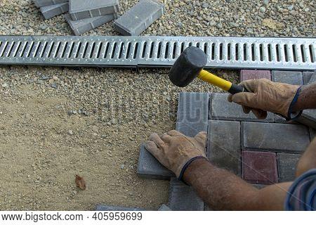 Stone Block Sidewalk. Road Paving, Construction, Sidewalk Repair. Selective Focus.