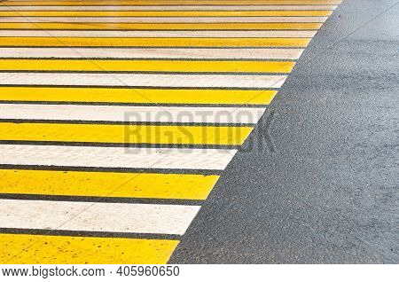 Crosswalk On The Street For Safety, White And Yellow Stripes