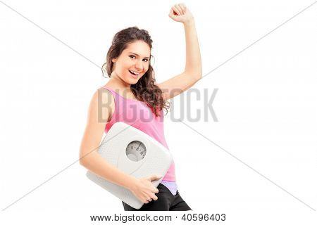 A young happy female holding a weight scale isolated on white background