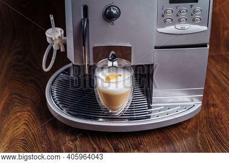 Making Fresh Coffee Going Out From A Coffee Espresso Machine. Making Capuccino In Glass Transparent