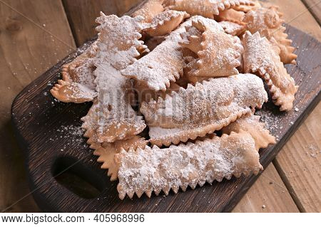 Traditional Italian Carnival And Typical Food. Sfrappole Or Chiachiere Or Angel Wings On A Woody Bac