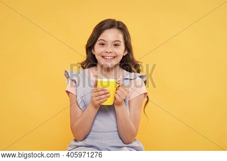 Milk Is Her Best Friend. Happy Girl Hold Cup Of Milk Yellow Background. Enjoying Natural Cows Milk.