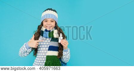 Teen Girl With Nasal Spray. No Addiction To Medicals. Copy Space. Kid In Warm Sweater Feel Cold. Kee