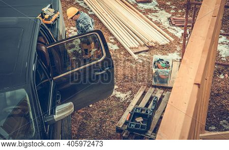 Caucasian Construction Contractor Worker In Yellow Hard Hat Preparing Himself In Front Of His Compan
