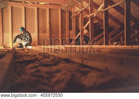 Caucasian Construction Worker In His 40s In The Newly Built Wooden House Attic. Wood Building Theme.