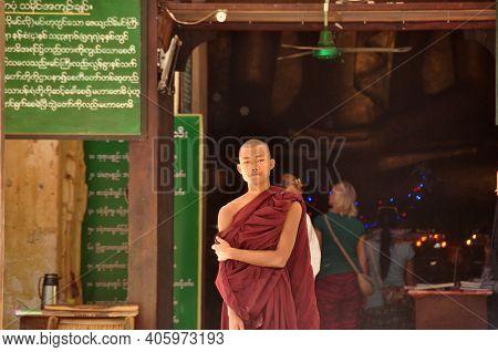Bagan, Myanmar - Nov 13, 2015: Ethnic Monk Portrait. Young Asian Man In Robe Of Monk Standing In Fro