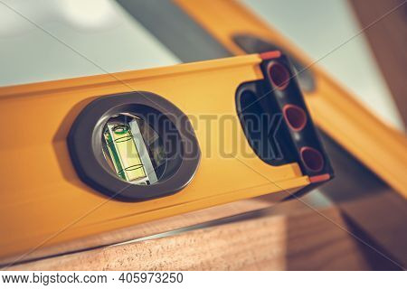 Spirit Level Tool Close Up. Levelling Horizontal And Vertical. Measurement Tool On Wooden Beam.