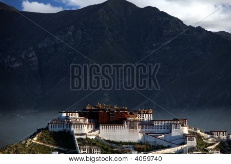 Potala Palace in Lhasa with mountain as background.