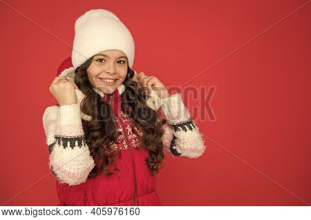 Feeling Cosy In Warm Clothes. Winter Fashion. Portrait Of Pure Beauty. Small Girl Long Curly Hair. C