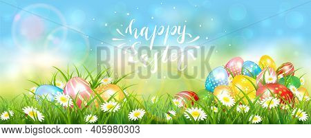 Easter Banner With Colorful Eggs In The Grass With Flowers. Lettering Happy Easter On Blue Sky Backg